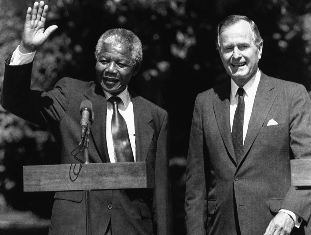 . President George Bush greets South African leader Nelson Mandela on the South Lawn of the White House, Monday, June 26, 1990, Washington, DC. Mandela told Bush the support blacks in South Africa have received from the United States, particularly economic sanctions, have been crucial promoting changes in his country. (AP Photo/Doug Mills)