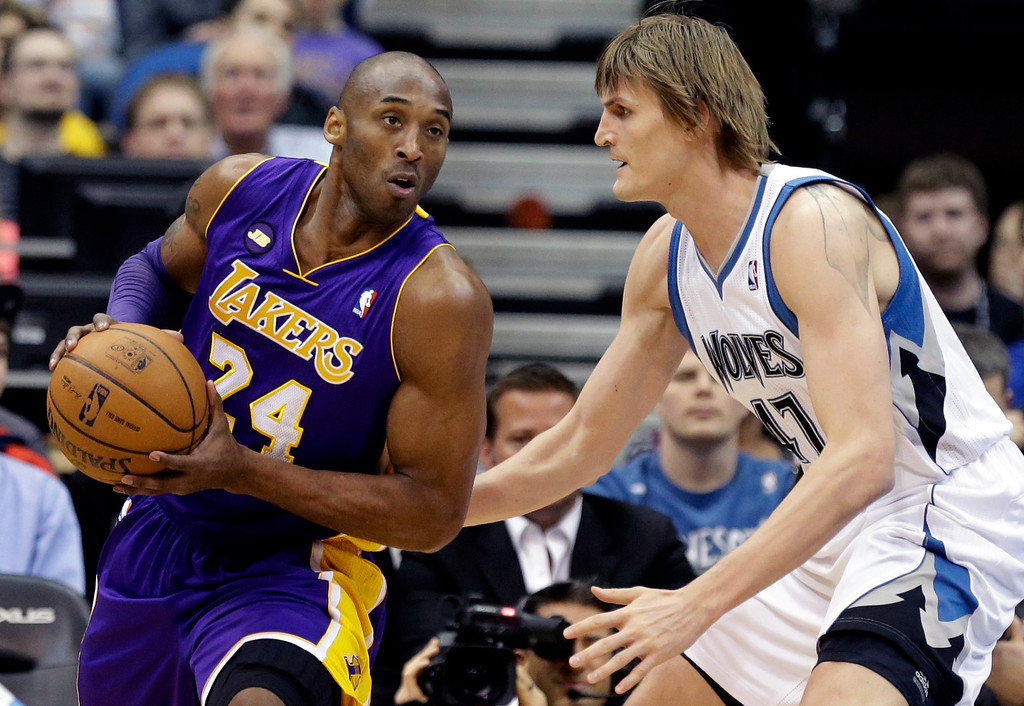 . Los Angeles Lakers\' Kobe Bryant, left, drives around Minnesota Timberwolves\' Andrei Kirilenko of Russia in the first quarter of an NBA basketball game Wednesday, March 27, 2013 in Minneapolis. (AP Photo/Jim Mone)