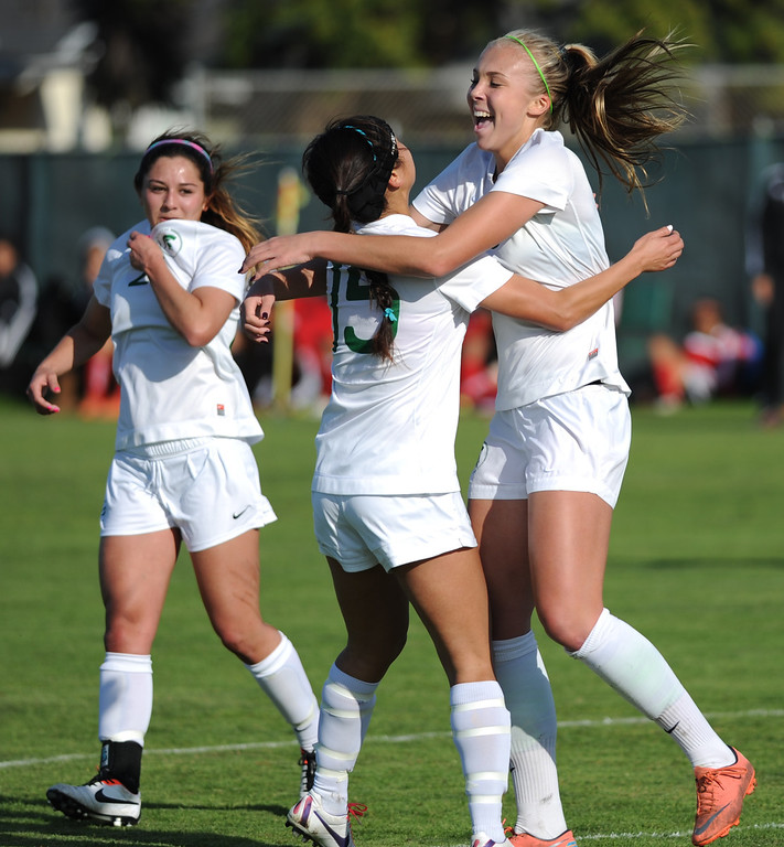 . 02-21-2012--(LANG Staff Photo by Sean Hiller)- South Torrance girls soccer beat Artesia 5-0 in Thursday\'s CIF Southern Section Division IV quarterfinal at South High. Kyla Diekmann celebrates her third goal to complete a hat trick as she runs to teammates Noelle Ly (15), center, and Jessica Nakae (27), left, in the first half.