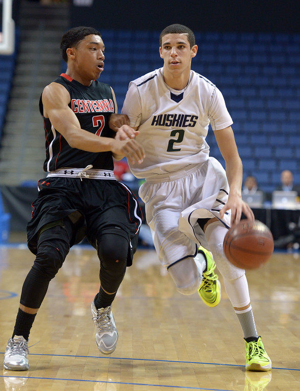 . Chino Hills\' Lonzo Ball brings the ball up the court and is defended by Sedrick Barefield at Citizens Business Bank Arena in Ontario, CA on Saturday, March 22, 2014. Chino Hills vs Centennial in the CIF boys Div 1 regional final. 1st half. Photo by Scott Varley, Daily Breeze)