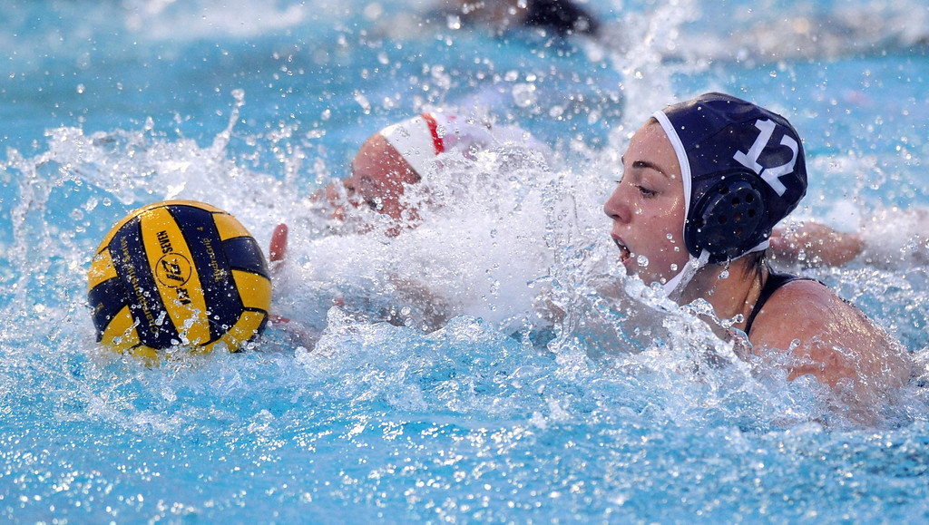 Description of . Crescenta Valley's Shannon Hovanesian (#12) battles for the ball as they play Redlands East Valleyin the Southern Section Div. V semifinals girls water polo game at Whittier College's Lillian Slade Aquatics Center on Wednesday February 20, 2013. Crescenta Valley beat Redlands East Valley 14-4. (Staff photo by Keith Durflinger)