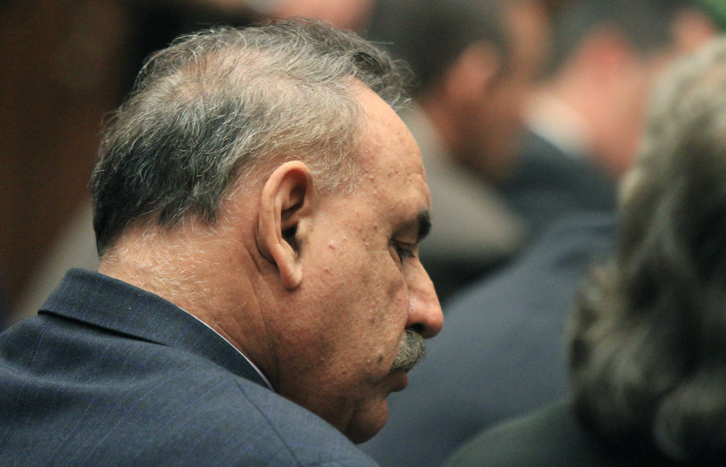. Oscar Hernandez, former mayor of Bell, Calif.  listens to the judge as a guilty verdict is read in his trial on Wednesday, March 20, 2013, in Los Angeles.  Hernandez and four former elected officials were convicted of multiple counts of misappropriation of public funds, and a sixth defendant was cleared entirely. Hernandez and co-defendants George Cole, Teresa Jacobo, George Mirabal,  and Victor Belo were all convicted of multiple counts and acquitted of others.  The charges against them involved paying themselves inflated salaries of up to $100,000 a year in the city of 36,000 people, where one in four residents live below the poverty line.   (AP Photo/Los Angeles Times, Irfan Khan, Pool)
