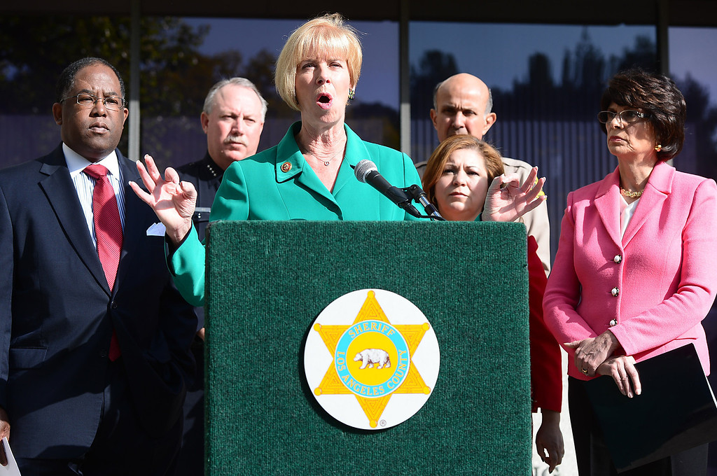 Description of . Congresswoman Janice Hahn speaks to the press in support of Congresswoman Linda Sanchez' legislation to assist law enforcement with gun buyback programs Thursday, February 21, 2013 at Los Angeles County Sheriff's Headquarters. (SGVN/Staff Photo by Sarah Reingewirtz)