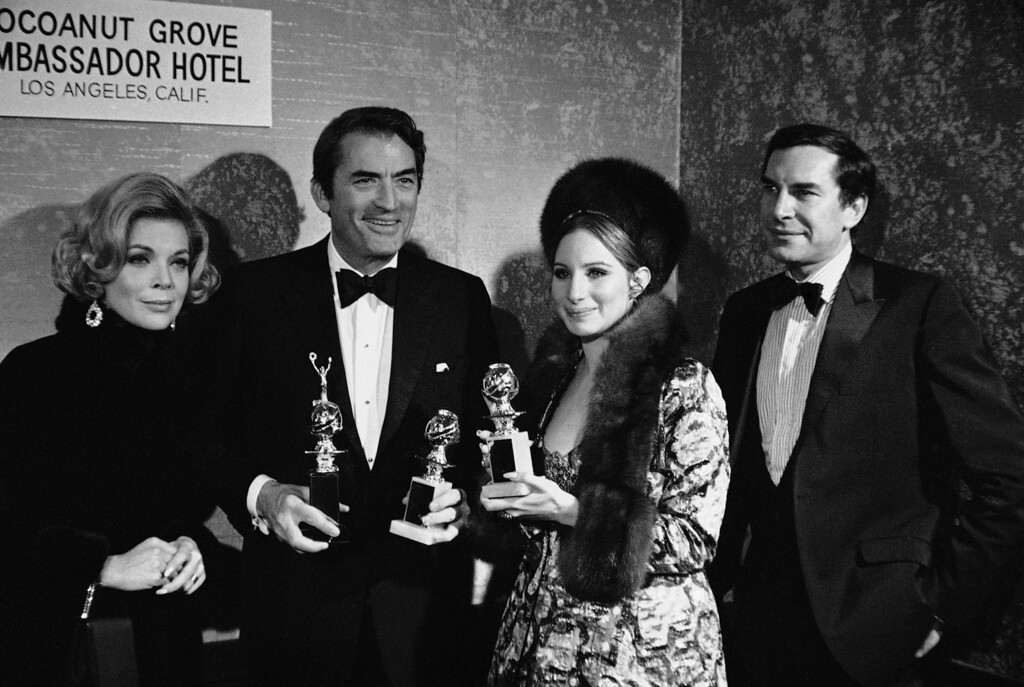 ". Gregory Peck and Barbra Streisand hold the Golden Globes they won in Hollywood last night from the Hollywood Foreign Press Association at the group\'s annual awards banquet on Feb. 24, 1969 in Los Angeles. Peck was awarded the Cecil B. DeMille award for outstanding achievement. Streisand was named top performer of the year in a musical or comedy for her role in ""Funny Girl.\"" Peck also holds the globe he accepted for the absent Ron Moody, named best actor in a musical or comedy for his part in \""Oliver.\"" (AP Photo)"