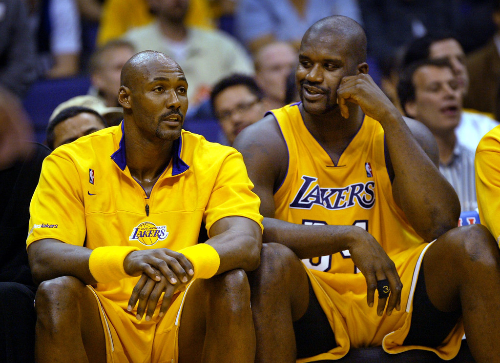 . The Los Angeles Lakers\' Shaquille O\'Neal, right, talks with new teammate Karl Malone during the second quarter of their game against the Dallas Mavericks in Los Angeles, Tuesday, Oct. 28, 2003. (AP Photo/Kevork Djansezian)