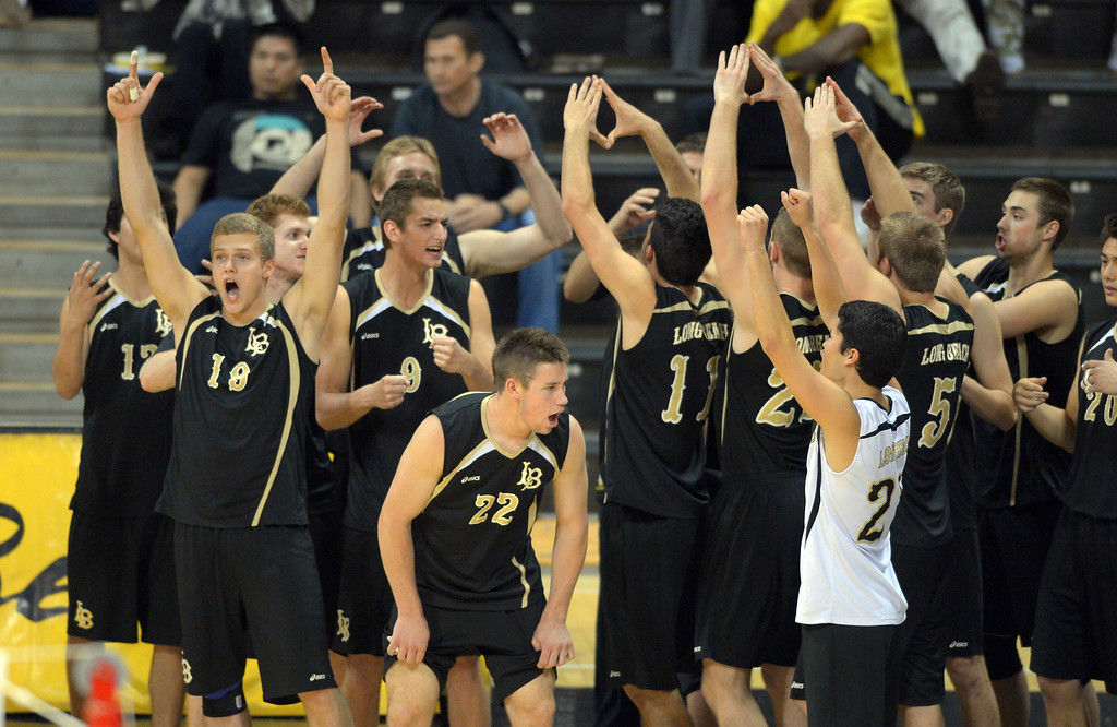. LBSU bench players celebrate a point over BYU in Long Beach, CA on Friday, March 7, 2014 #2 BYU vs #3 Long Beach State men\'s volleyball at Walter Pyramid. (Photo by Scott Varley, Daily Breeze)