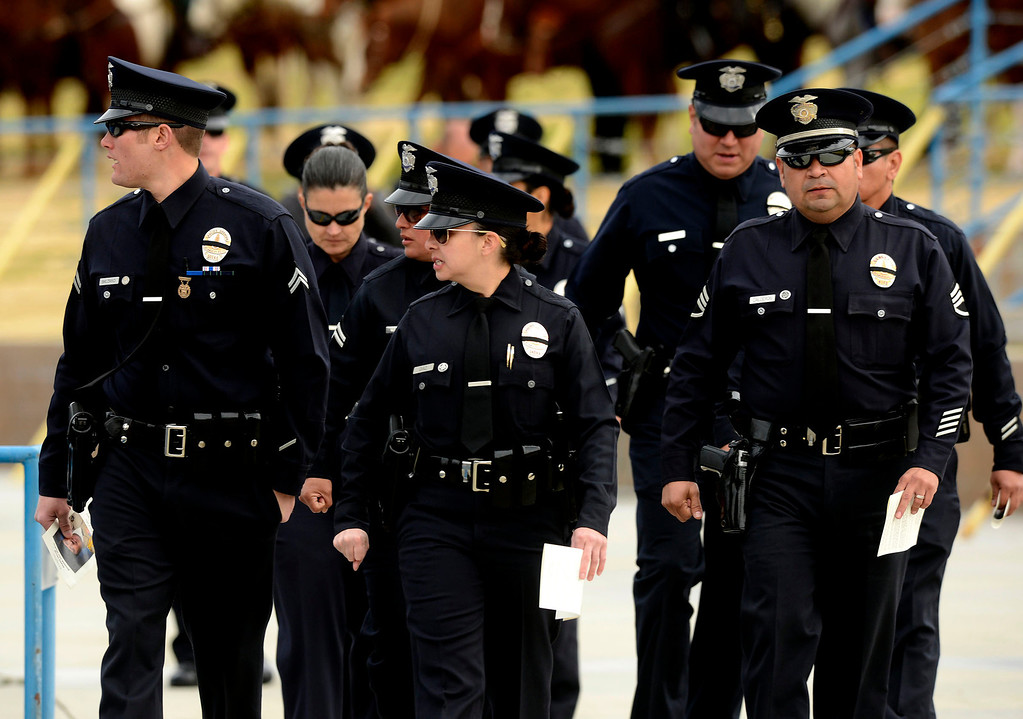 Description of . Members of the Los Angeles Police Department enter memorial services for San Bernardino County Sheriff Deputy Jeremiah MacKay at the San Manuel Amphitheater in Devore February 21, 2013.  GABRIEL LUIS ACOSTA/STAFF PHOTOGRAPHER.