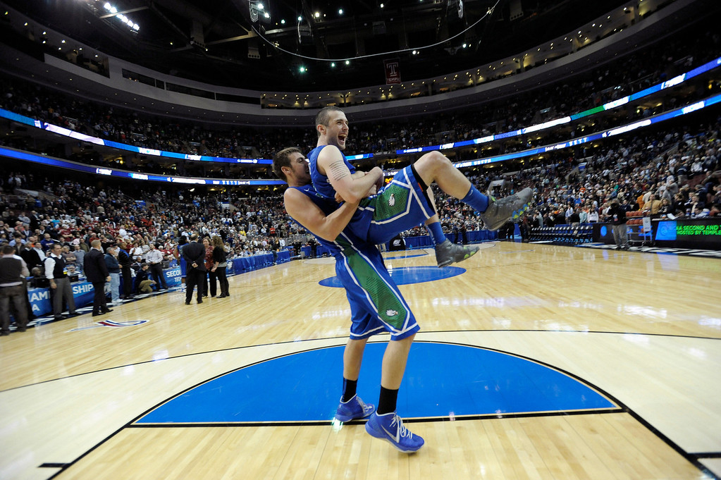 . Florida Gulf Coast\'s Brett Comer, right, and Chase Fieler celebrate after winning a second-round game against Georgetown 78-68 in the NCAA college basketball tournament on Friday, March 22, 2013, in Philadelphia. (AP Photo/Michael Perez)