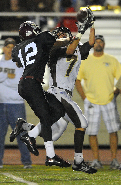 . West High takes on Torrance in a non league football game at Zamperini Stadium in Torrance, CA on Thursday, September 12, 2013. West\'s Kurtis Guelff hauls in a long pass as he\'s defended by Torrance\'s Roland Nilarp. (Photo by Scott Varley, Daily Breeze)