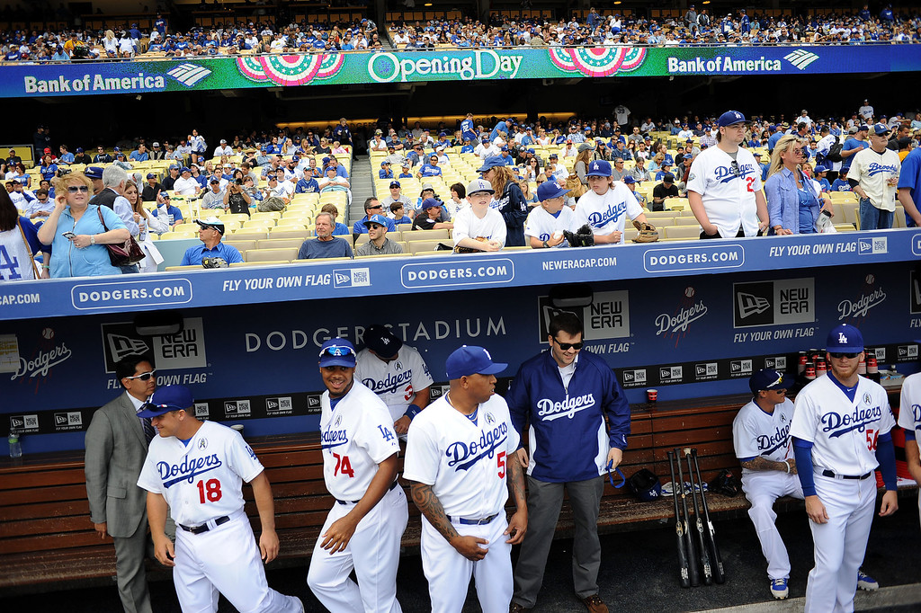. Dodger players file into their dugout on opening day at Dodger Stadium April 1, 2013.  The Dodgers hosted the San Francisco Giants.(Andy Holzman/Staff Photographer)