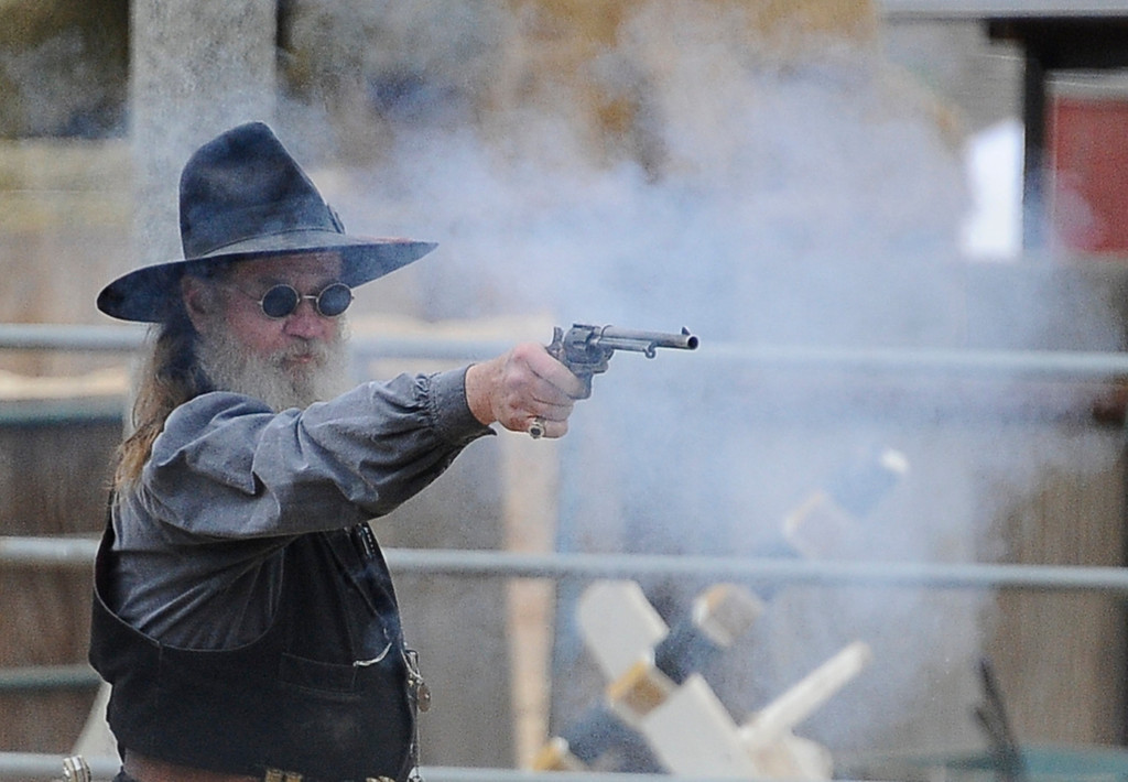 . Charityville  jail re-enactment  team perform a bank robbery shoot out during the 2013 Chatsworth\'s 10th Annual Day of the Horse celebration. This event will also celebrate Chatsworth\'s 125th birthday  April 14,2013. Chatsworth CA. Photo by Gene Blevins/LA Daily News
