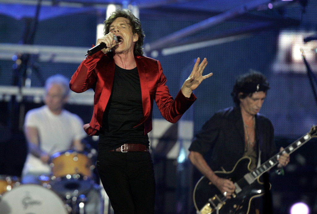 ". Mick Jagger of the Rolling Stones performs during the Rolling Stones\' ""A Bigger Bang\"" concert in Buenos Aires, Argentina Tuesday, Feb. 21, 2006. (AP Photo/Natacha Pisarenko)"
