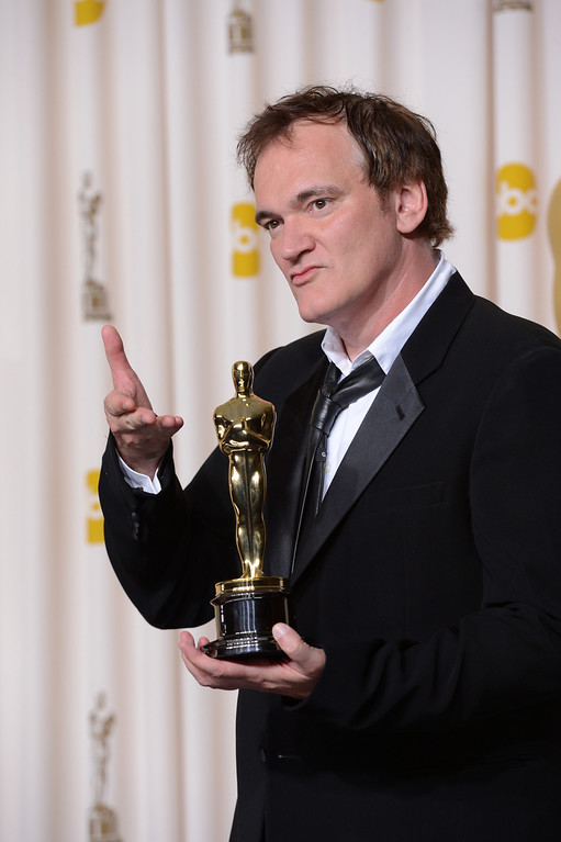 """. Quentin Tarantino accepts the award for best original screenplay for \""""Django Unchained\"""" backstage at the 85th Academy Awards at the Dolby Theatre in Los Angeles, California on Sunday Feb. 24, 2013 ( David Crane, staff photographer)"""