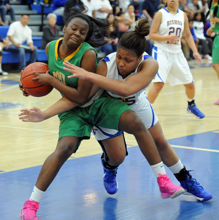 Description of . Long Beach Poly's Tania Lamb fights for the ball against Bishop Amat's Leeah Powell in the first half of a CIF State Southern California Regional semifinal basketball game at Bishop Amat High School on Tuesday, March 12, 2013 in La Puente, Calif. Long Beach Poly won 52-34.  (Keith Birmingham Pasadena Star-News)