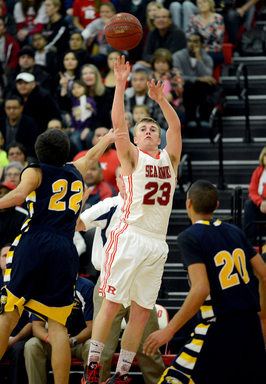 . Redondo Union\'s Derek Biale (23) scores another three point basket over Arroyo Grande\'s Cobe Williams (22) in a CIF Southern Section Division II-A semifinal boys basketball game Tuesday night in Redondo Beach. 20130226 Photo by Steve McCrank / Staff Photographer