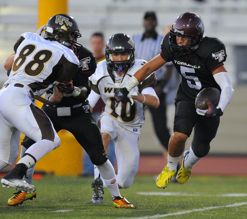 . West High takes on Torrance in a non league football game at Zamperini Stadium in Torrance, CA on Thursday, September 12, 2013. Torrance\'s Sean Luna scrambles. (Photo by Scott Varley, Daily Breeze)