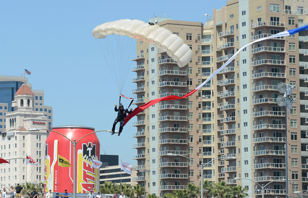 . Long Beach, Calif., -- 04-20-13-    Parachutist lands on the track before the Toyota Pro/Celebrity race  Saturday at the 39 Annual Toyota Grand Prix of Long Beach.   Stephen Carr/  Los Angeles Newspaper Group