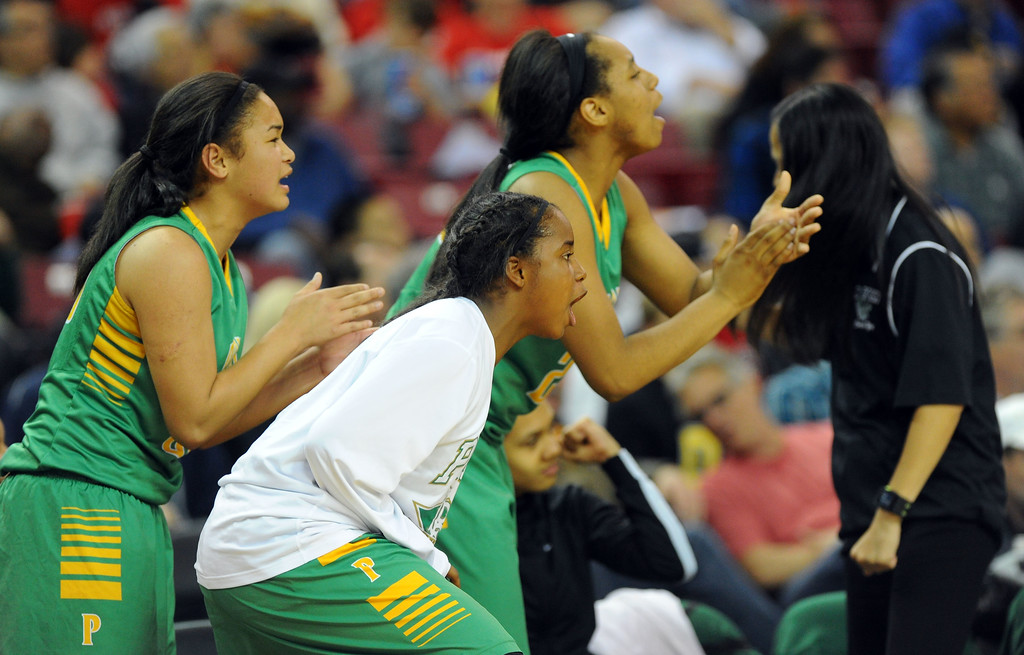 . Poly bench player cheer on their teammates at Sleep Train Arena in Sacramento, CA on Saturday, March 29, 2014. Long Beach Poly vs Salesian in the CIF Open Div girls basketball state final. 2nd half. Poly won 70-52. (Photo by Scott Varley, Daily Breeze)