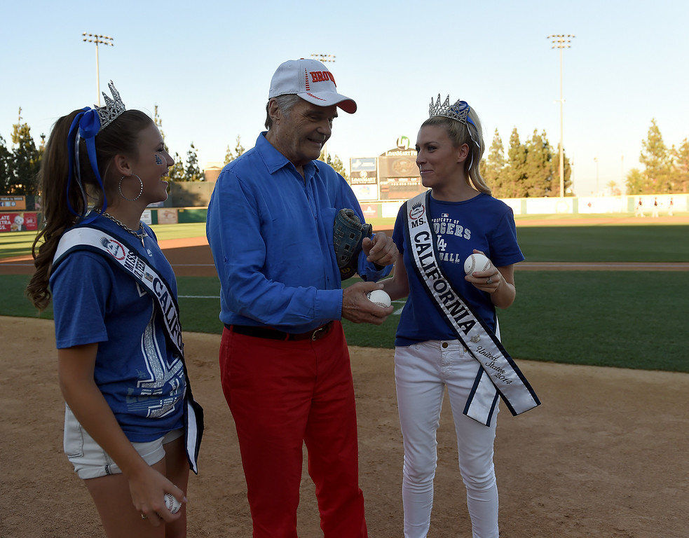 Description of . Ms. Jr. Teen California Alina Carranza, left, Actor Fred Willard and Ms. California 2014 Sande Charles prepare to throw out the first pitches at the Quakes game at LoanMart Field in Rancho Cucamonga, CA, Friday, August 15, 2014. (Photo by Jennifer Cappuccio Maher/Inland Valley Daily Bulletin)