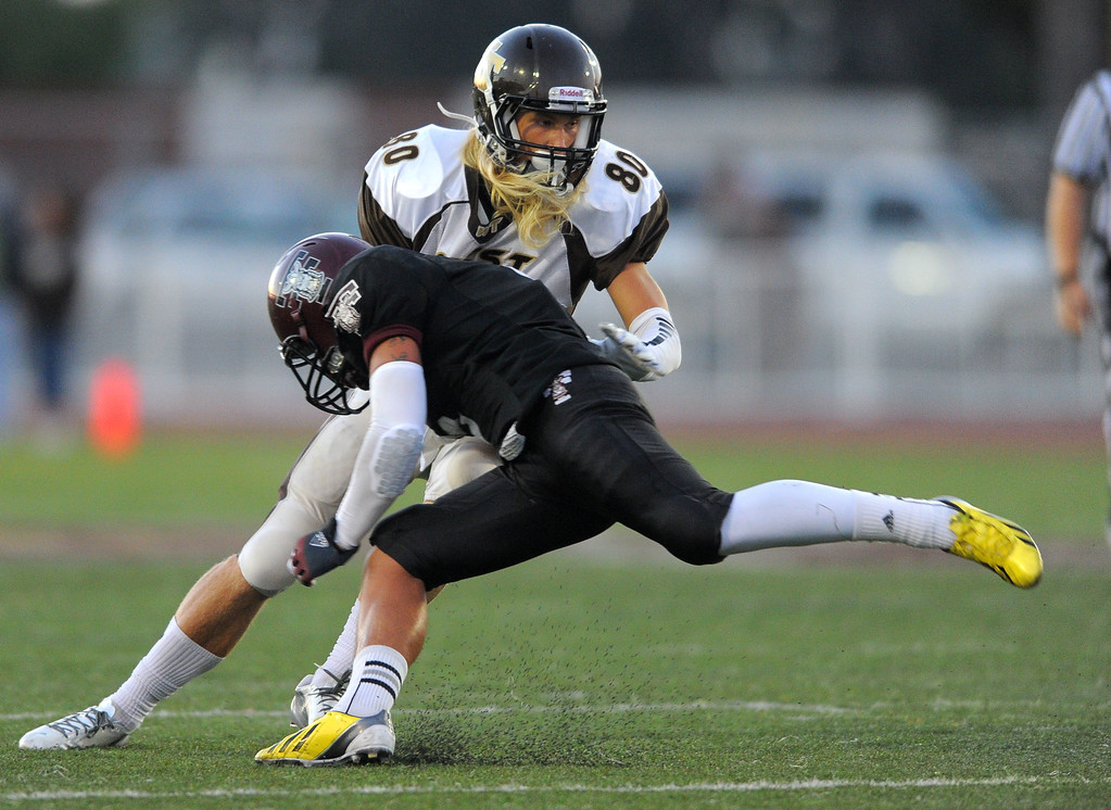 . West High takes on Torrance in a non league football game at Zamperini Stadium in Torrance, CA on Thursday, September 12, 2013. West receiver Craig Knaus escapes a tackle attempt by Torrance\'s Sean Luna. (Photo by Scott Varley, Daily Breeze)