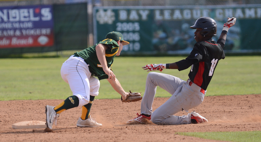 . MC SS#7 Jack Hadley tags out Westchester runner 11Pernell Roberts Jr. at second in 3rd inning. Mira Costa defeated Westchester 2-1 at home in boy\'s baseball.  Photo by Brad Graverson 3-26-13