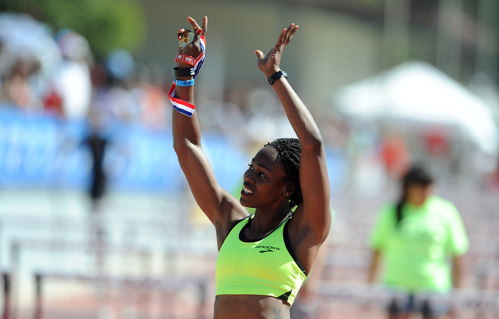 Description of . Yvette Lewis of Brooks waves to the crowd after winning the 100 meter hurdles invitational elite during the Mt. SAC Relays in Hilmer Lodge Stadium on the campus of Mt. San Antonio College on Saturday, April 20, 2012 in Walnut, Calif.    (Keith Birmingham/Pasadena Star-News)