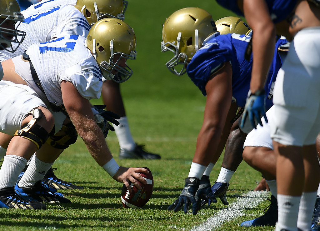 Description of . The UCLA Bruins football practice at Cal State San Bernardino in San Bernardino, CA, Friday, August 8, 2014. (Photo by Jennifer Cappuccio Maher/Inland Valley Daily Bulletin)