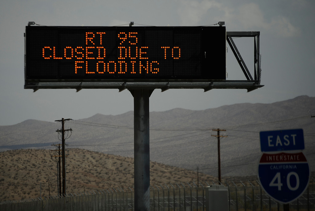 . A freeway sign warns driver that highway 95 just north of highway 40 west of Needles California, that its closed due to flooding. Drivers were stuck for hours until Caltrans arrived late in the evening to start to remove the mud that came from heavy monsoon storms today in the deserts areas. Needles CA, Aug 25,2013. Photo by Gene Blevins/LA Daily News