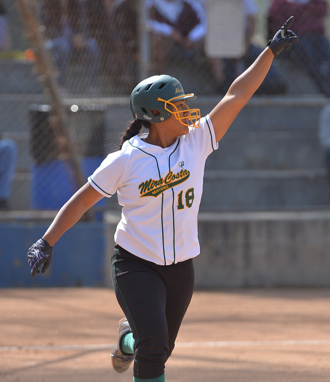 . 0517_SPT_TDB-L-MC-TORRANCE--- Torrance, CA--5/16/13--- Staff Photo: Robert Casillas  - Daily Breeze / LANG--- Mira Costa defeated Torrance High 7-1 in CIF DIV III softball playoff game at Wilson Park in Torrance. Mira Costa\'s Fa Lefua leaves no doubt about where her solo home run blast is heading. Her homer in 2nd inning capped a seven run binge.