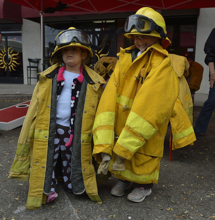 . TORRANCE, CALIF. USA -- Stacey and Stephanie Balestrieri done fire fighting gear in Torrance, Calif., on April 14, 2013. The Old Torrance Festival Day is a charity fundraiser that will benefits the South Bay Police and Fire Memorial Foundation and the Torrance Relay for Life. Photo by Jeff Gritchen / Los Angeles Newspaper Group