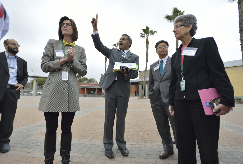 . LONG BEACH, CALIF. USA -- Cabrillo High School Co-Principal Alejandro Vega gives a campus tour to California senate senators Mimi Walters (R-Irvine), left, Ted Lieu (D- Torrance) and Hannah-Beth Jackson (D-Santa Barbara) in Long Beach, Calif., on March 5, 2013. About 20 state senators toured classrooms at the West Long Beach school as part of the Senate Education Policy Conference. Photo by Jeff Gritchen / Los Angeles Newspaper Group