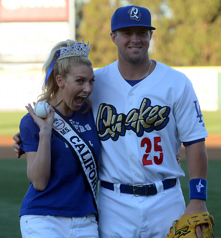 Description of . Ms. California 2014 Sande Charles poses with a Quakes player after throwing out the first pitch before the Quakes game at LoanMart Field in Rancho Cucamonga, CA, Friday, August 15, 2014. (Photo by Jennifer Cappuccio Maher/Inland Valley Daily Bulletin)