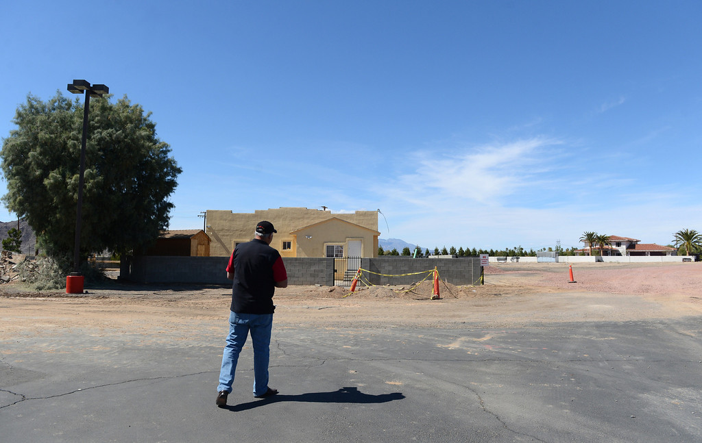 Description of . Businessman Luis Ramallo walks towards the area where the new development will be at Alien Fresh Jerky in Baker, CA, Thursday, April 3, 2014. Ramallo is planning to build a UFO shaped hotel behind the popular Alien Fresh Jerky store. (Photo by Jennifer Cappuccio Maher/Inland Valley Daily Bulletin)
