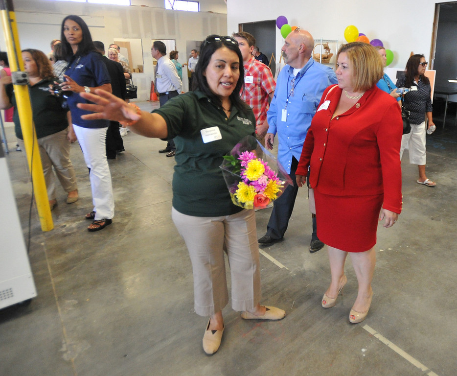 Description of . Veronica Hernandez shows Congresswoman Linda Sanchez around their new location at the Interfaith Food Center in Santa Fe Springs on Wednesday August 21, 2013. The Interfaith Food Center is a non-profit, previously located in unincorporated Whittier for 30 years, providing food services to the neediest residents of Whittier and La Mirada.