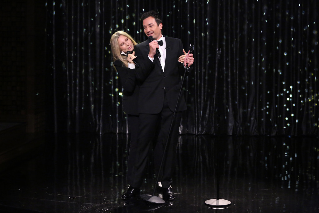 ". In this image released by NBC, host Jimmy Fallon sings a medley of duets with Barbra Streisand during ""The Tonight Show Starring Jimmy Fallon,\"" on Monday, Sept. 15, 2014 in New York. Streisand is promoting her new album, \""Partners,\"" a collection duets. (AP Photo/NBC, Douglas Gorenstein)"