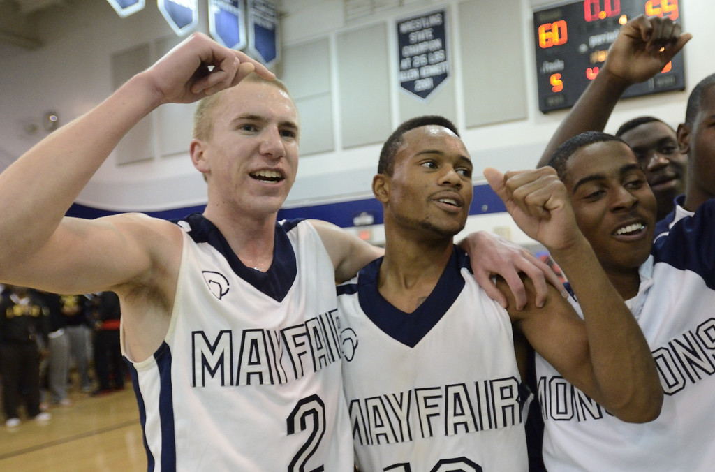 . LAKEWOOD, CALIF. USA -- Mayfair\'s Mark Patterson (2) and Jarrod Sheffield (12) celebrate their win of La Mirada in Lakewood, Calif., on February 8, 2013. Mayfair defeated La Mirada 60 to 59. Photo by Jeff Gritchen / Los Angeles Newspaper Group