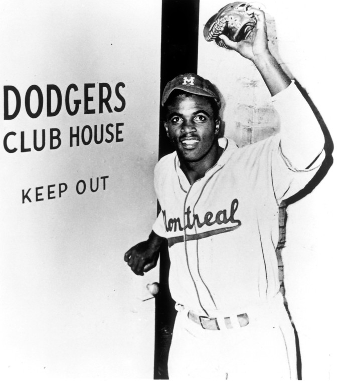 Description of . Jackie Robinson entering the Dodgers Club House in his minor league uniform.  Daily News file photo
