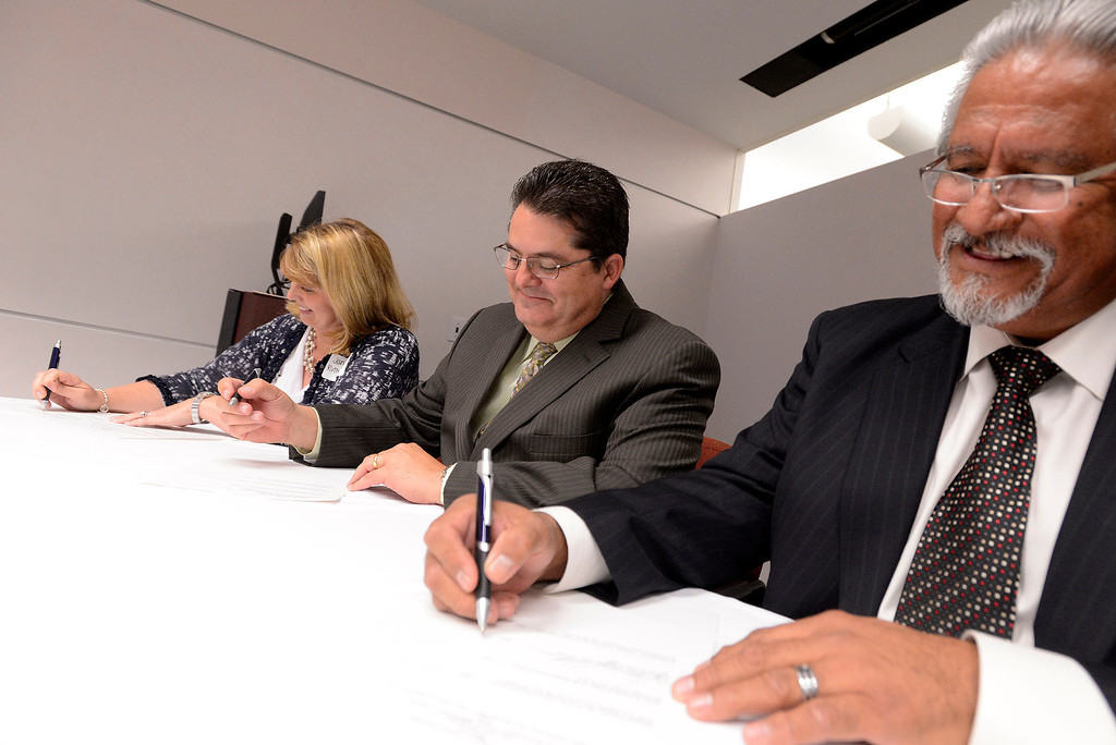 Description of . From left to right:  Supervisor Janice Rutherford, Los Angeles Newspaper Group Vice President Michael Anastasi, and Dean Cesar Caballero sign over the transferal of The Sun's archives to the County at California State University San Bernardino April 8, 2013.   GABRIEL LUIS ACOSTA/STAFF PHOTOGRAPHER.