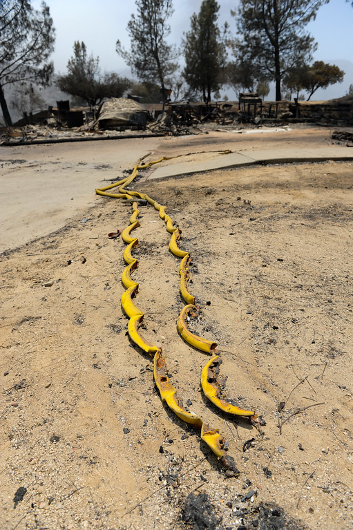 . Burnt fire hoses at a burnt house on Newview Drive in Lake Hughes from the Powerhouse Fire, Sunday, June 2, 2013. (Michael Owen Baker/Staff Photographer)
