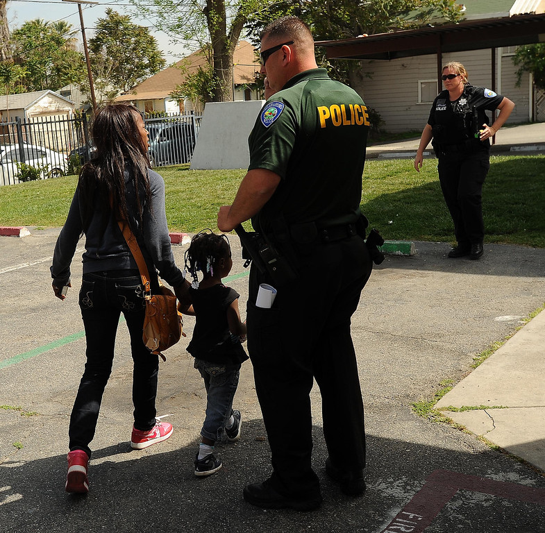 Description of . San Bernardino Police SMASH Unit officer Ray Bonshire helps conduct a sweep along the 1100 block Mayfield Drive in San Bernardino April 4, 2013. GABRIEL LUIS ACOSTA/STAFF PHOTOGRAPHER.