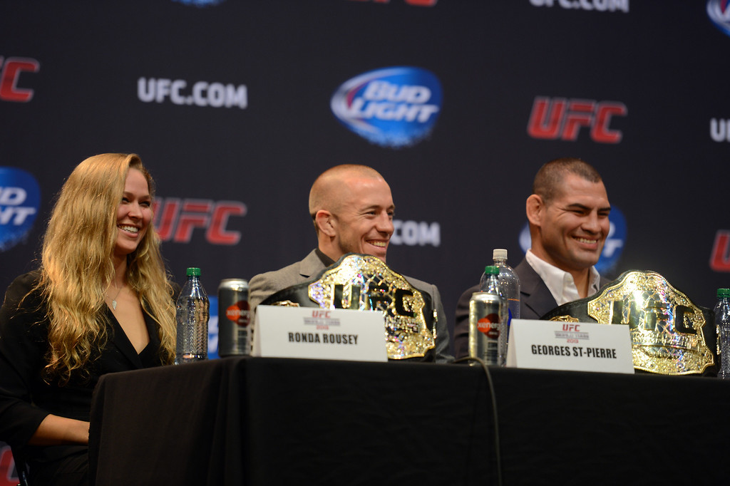 . UFC champions Ronda Rousey, George St-Pierre, and Cain Velasquez during the UFC World Tour at Club Nokia Tuesday, July 30, 2013 in Los Angeles. (Hans Gutknecht/Los Angeles Daily News)
