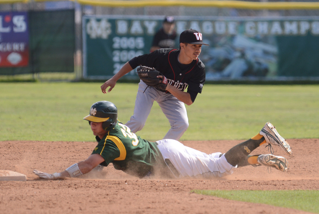 . MC runner 32 Garrett Wells is out at second on steal attempt vs. Westchester 25 Javier Garcia. 2B. Mira Costa defeated Westchester 2-1 at home in boy\'s baseball.  Photo by Brad Graverson 3-26-13