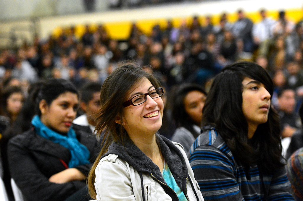 Description of . From left, Sophia Sandoval, 17, Natalia Rodriguez, 17, and Michael Ramirez, 16, all juniors, listen to motivational speaker Keith Hawkins speak at Santa Fe High School Tuesday morning, March 19, 2013 as the Santa Fe Springs school holds their 23rd annual Diversity Summit this week. (SGVN/Staff Photo by Sarah Reingewirtz)