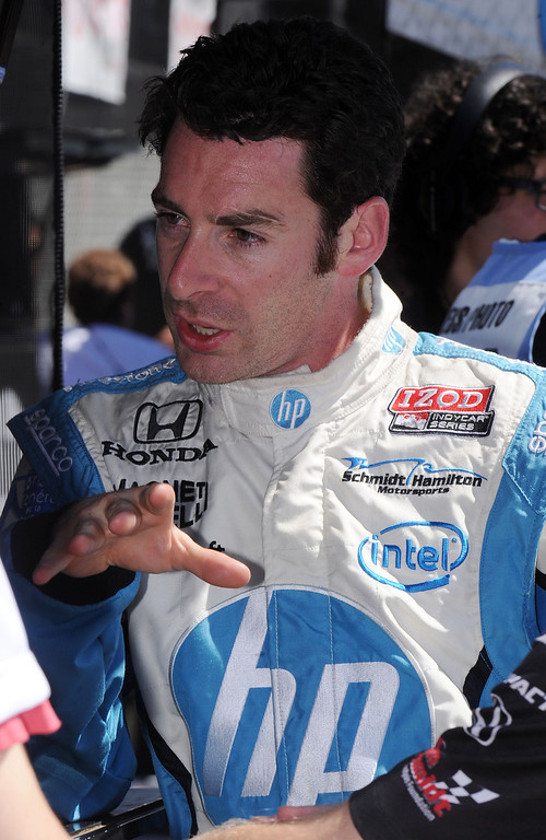. (Will Lester/Staff Photographer)  Indycar driver Simon Pagenaud, from Montmorillon, France, speaks with his crew in the pits Friday morning April 19, 2013 at the 39th annual Toyota Grand Prix of Long Beach.