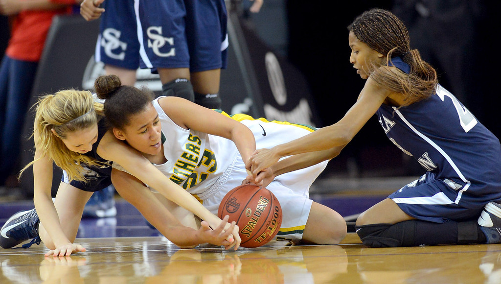 . Sierra Canyon\'s Gabi Nevill and Zoe Goss work to recover a loose ball against Chloe Eackles of Pinewood during the 2013 CIF State Basketball Championships at the Sleep Train Arena, in Sacramento, Ca March 22, 2013.  Sierra Canyon won the game 47-33.(Andy Holzman/Los Angeles Daily News)