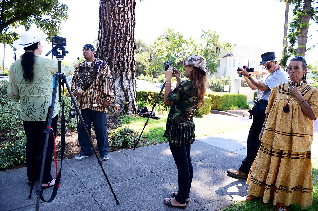 Description of . Wildlife activists are interviewed by media as they gather outside the Ninth Circuit Court of Appeals in Pasadena before attending a hearing on Bureau of Land Management's round-up of wild horses Thursday, August 29, 2013.  (Photo by Sarah Reingewirtz/Pasadena Star-News)