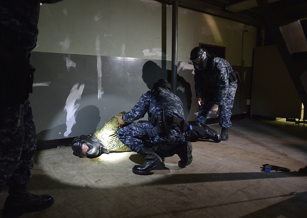 . SEAL BEACH, CALIF. USA -- Sailors assigned to security at the Seal Beach Naval Weapons Station Seal Beach arrest a suspect during an a active-shooter scenario drill on February 26, 2013.  Photo by Jeff Gritchen / Los Angeles Newspaper Group