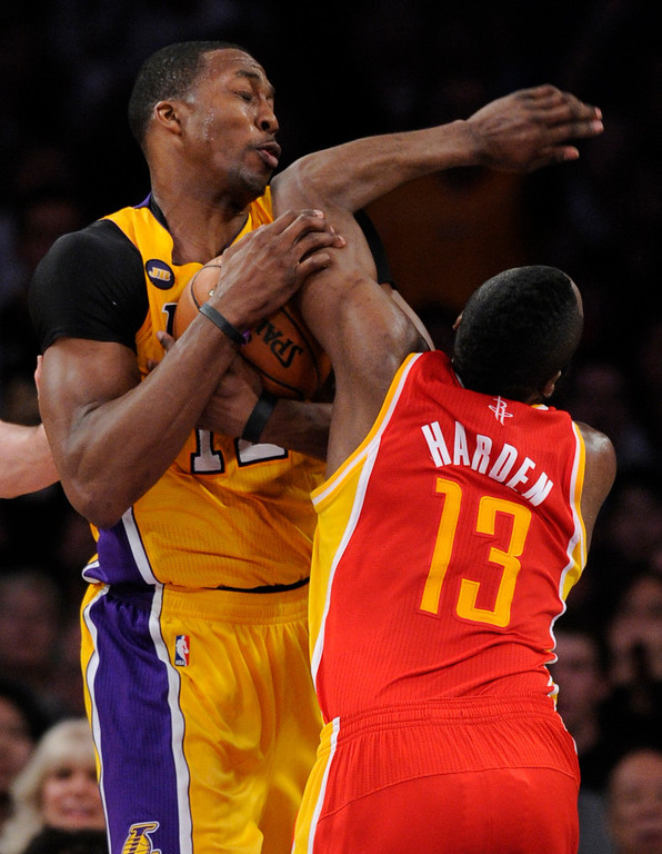. Lakers#12 Dwight Howard steals the ball from Rockets#13 James Harden in the final seconds of regulation. The Lakers defeated the Houston Rockets in overtime 99-95 in the final home game of the year at Staples Center in Los Angeles, CA 4/17/2013(John McCoy/Staff Photographer