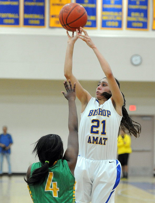 Description of . Bishop Amat's Paulina Santana (21) shoots over Long Beach Poly's Tania Lamb (4) in the second half of a CIF State Southern California Regional semifinal basketball game at Bishop Amat High School on Tuesday, March 12, 2013 in La Puente, Calif. Long Beach Poly won 52-34.  (Keith Birmingham Pasadena Star-News)