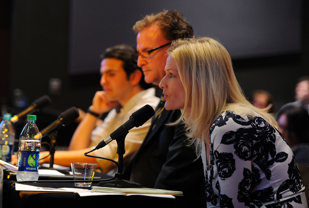 . Press-Telegram city editor Melissa Evans, right, asks a question to the mayoral candidates along with fellow moderators Daniel Serrano, left, and Daniel O\'Connor during a mayoral debate at CSULB\'s Beach Auditorium in Long Beach, CA on Wednesday, March 19, 2014. Photo by Scott Varley, Daily Breeze)